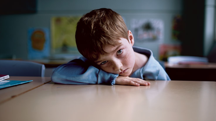 sad-boy-desk-leaning